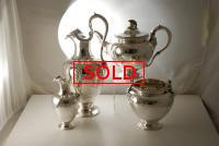 A Four Piece Sterling Victorian Silver Tea Set