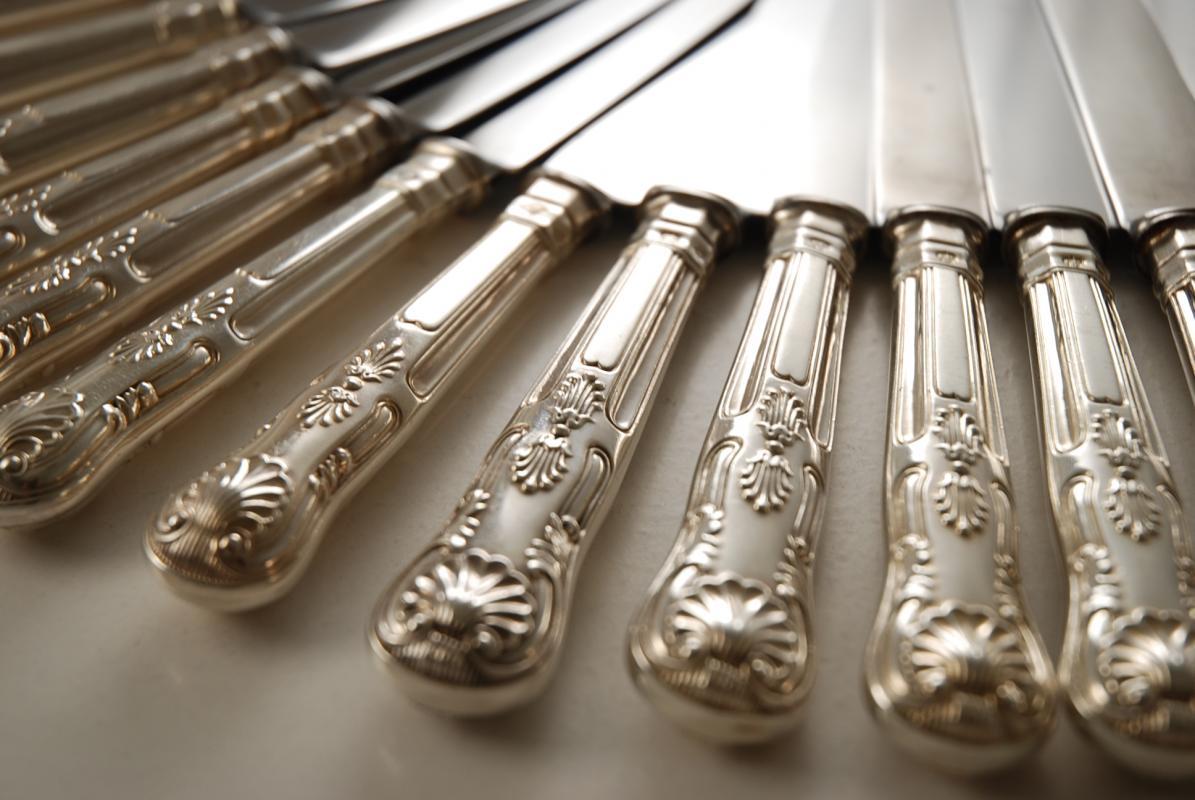 a silver flatware set of kings pattern knives