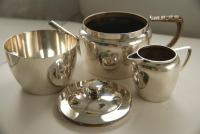 A Rare Sterling Silver Tea Set by Christopher Dresser