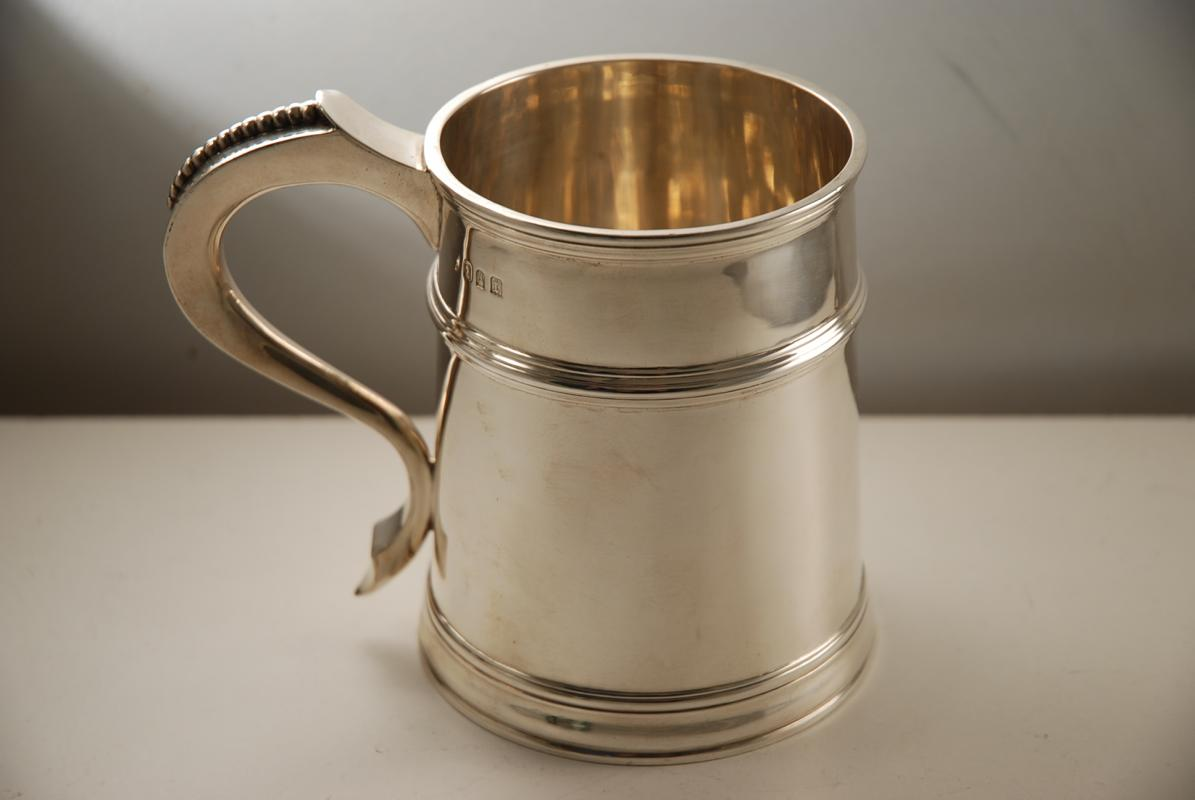 A Britannia Standard Silver Mug in the Queen Anne Style
