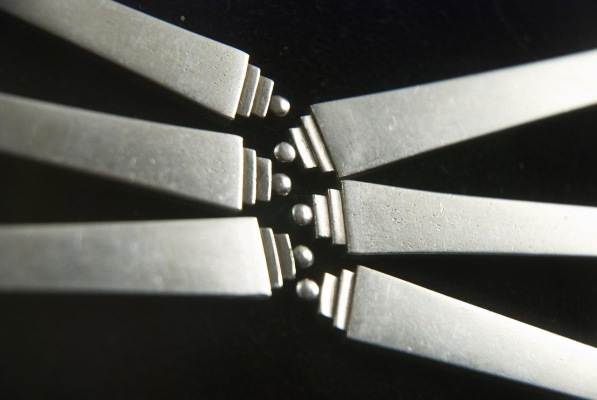 A Set of 6 Pyramid Pattern Silver Cake Forks by Georg Jensen