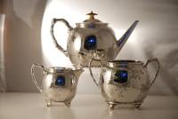 A Victorian Silver Plate Aesthetic Movement 3 Piece Tea Set